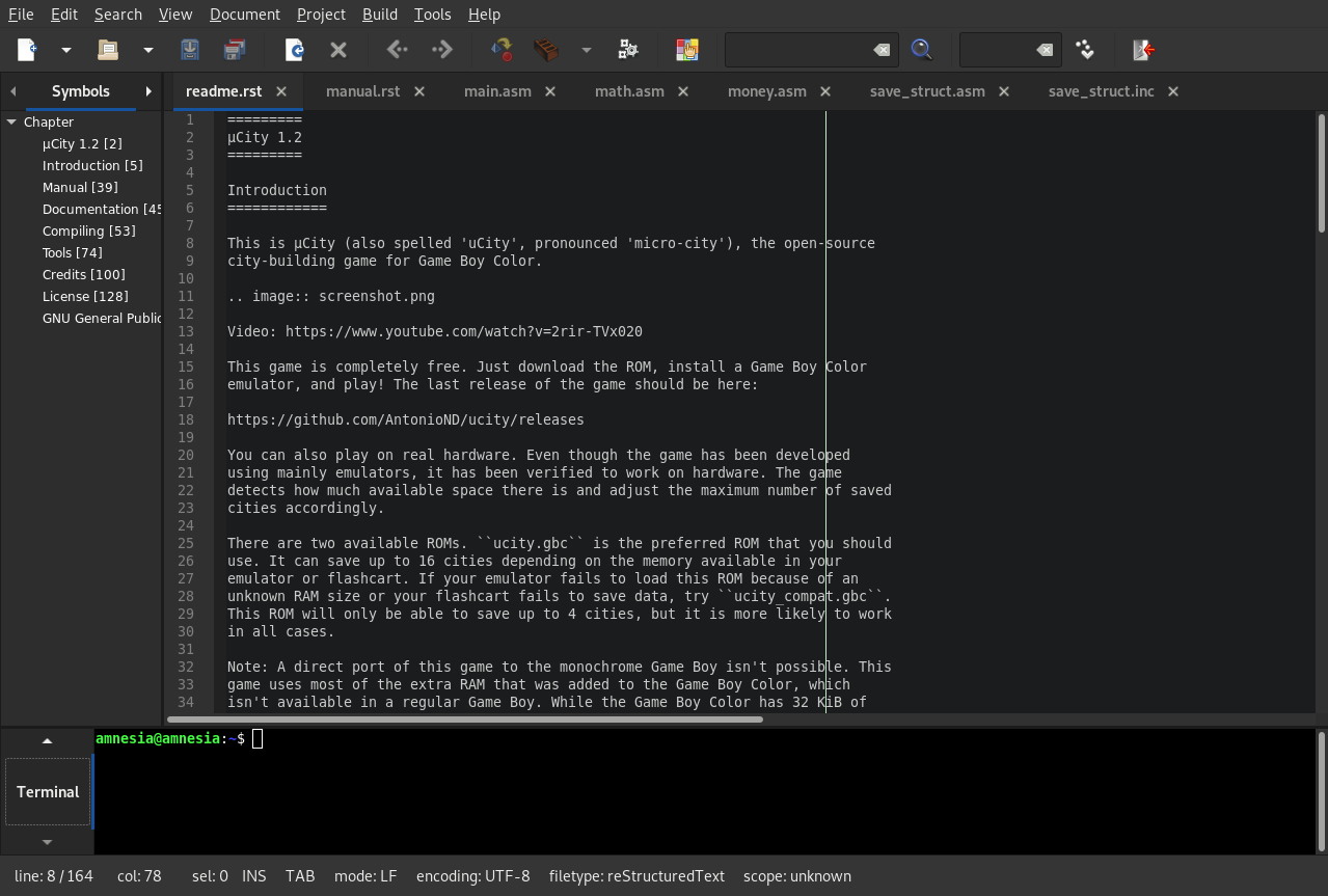 Geany with a dark color scheme (Himbeere) editing the µCity readme file.
